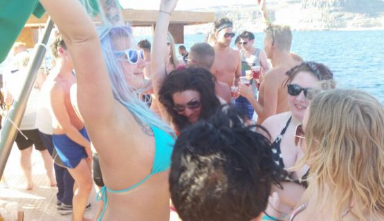 crowds dancing on the boat party