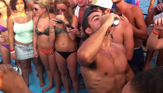 guy drinking on the boat party
