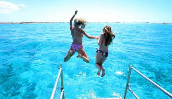 two girls jumping from the boat