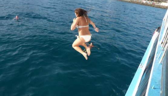 girl jumping on the party boat maspalomas